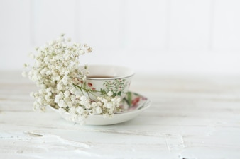 Decorative cup of tea with flowers