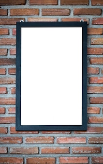 Decorative frame on brick wall
