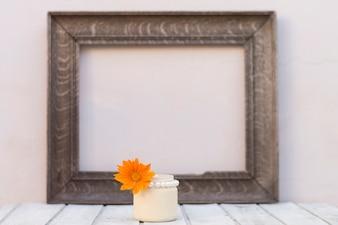 Decorative frame with orange flower