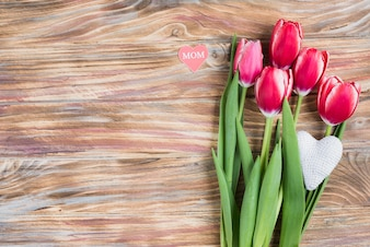 Decorative tulips on wooden surface for mother's day