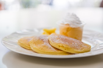 Delicious breakfast with pancakes