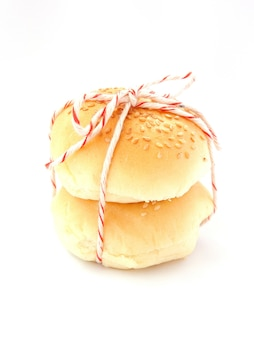 Delicious buns with sesame seeds on white background