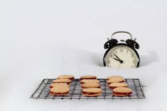 Delicious cookies next to a clock