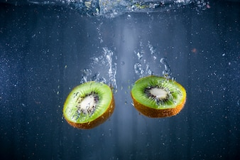 Delicious kiwis immersed in water