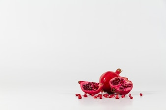 Delicious pomegranate on white surface