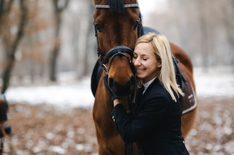 Delighted woman embracing horse
