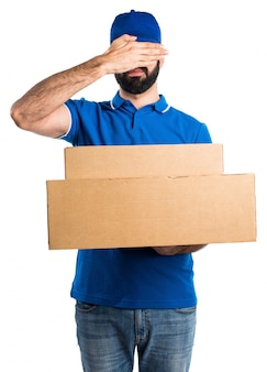 Delivery man covering his eyes