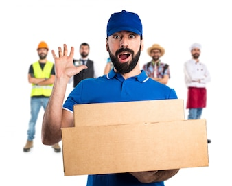Delivery man doing surprise gesture