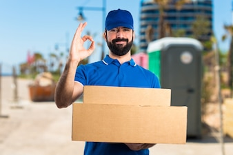 Delivery man making OK sign