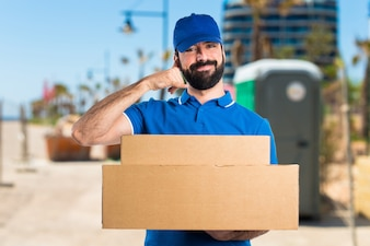 Delivery man making phone gesture
