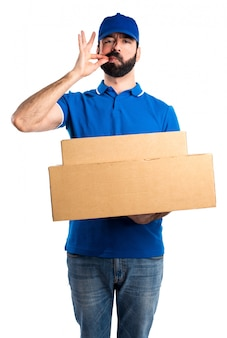 Delivery man making silence gesture