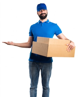 Delivery man presenting something