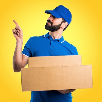 Delivery man thinking on colorful background