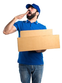 Delivery man yawning