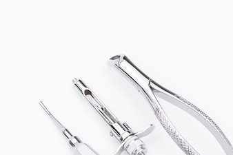 Dental tools and equipment on white background