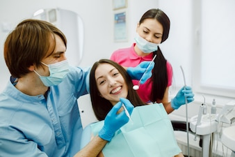 Dentist working with his assistant
