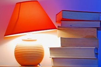 Desk lamp and books