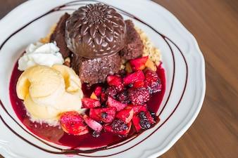 Dessert with strawberries and chocolate ice cream