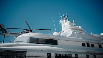 Detail of luxury yacht with a helicopter on the top.