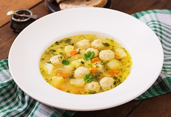 Dietary soup with chicken meatballs and stalks of celery