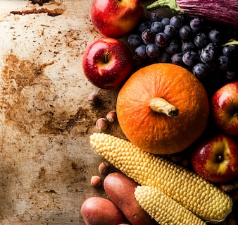 Different seasonal autumn vegetables and fruits old background
