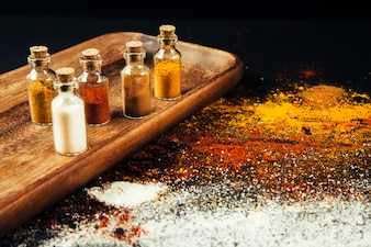 Different spices on wooden board