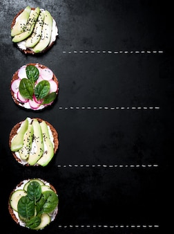 Dish with avocado and radish slices seen from top