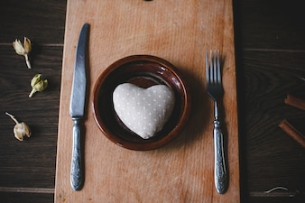 Dish with cutlery and a heart shape inside