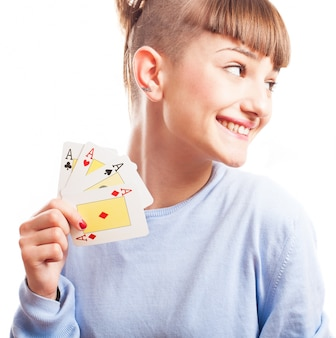 Distracted girl showing her cards