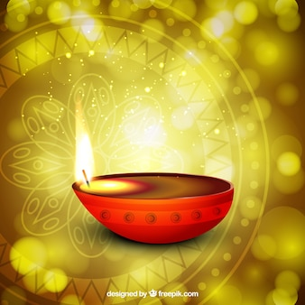 Diwali candle on bright background