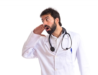 Doctor listening over isolated white background