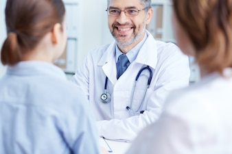 Doctor talking with patients