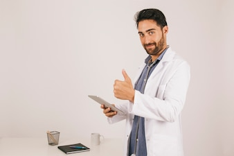 Doctor with ipad and thumb up
