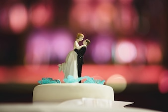 Dolls of a wedding cake dancing
