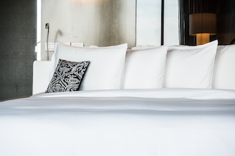 Double bed with a cushion and pillows