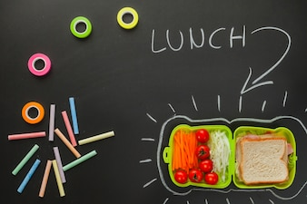 Drawings on blackboard with sandwich