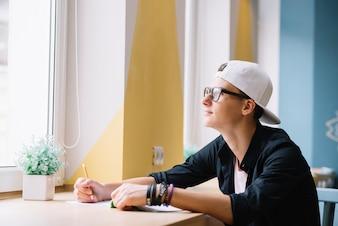 Dreaming schoolboy in classroom