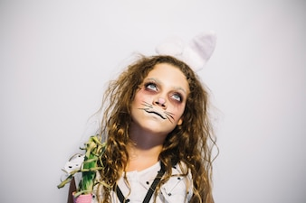 Dreamy girl in hare face paint