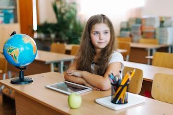Dreamy girl prepared to lesson