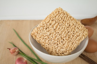 Dried Instant noodle on the wood table.