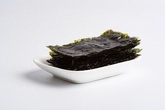 Dry seaweed on white background