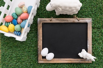 Easter background with decorative slate for messages