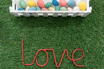Easter composition with eggs and word love