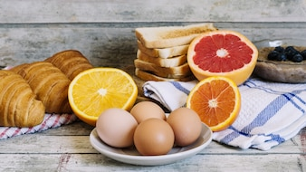 Eggs and fruits on table