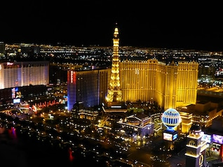 eiffel view las vegas night neon tower