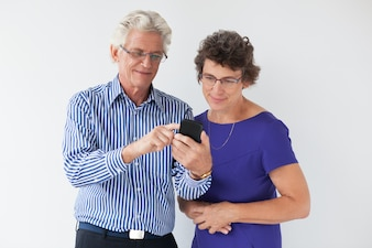 Elderly showing texting device communication