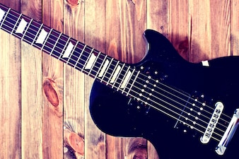 Electric guitar on a wooden table