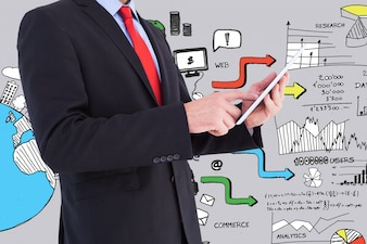 Elegant businessman with a tablet and background graphics