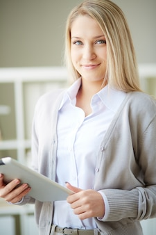 Elegant businesswoman holding a tablet