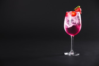 Elegant cocktail with strawberries